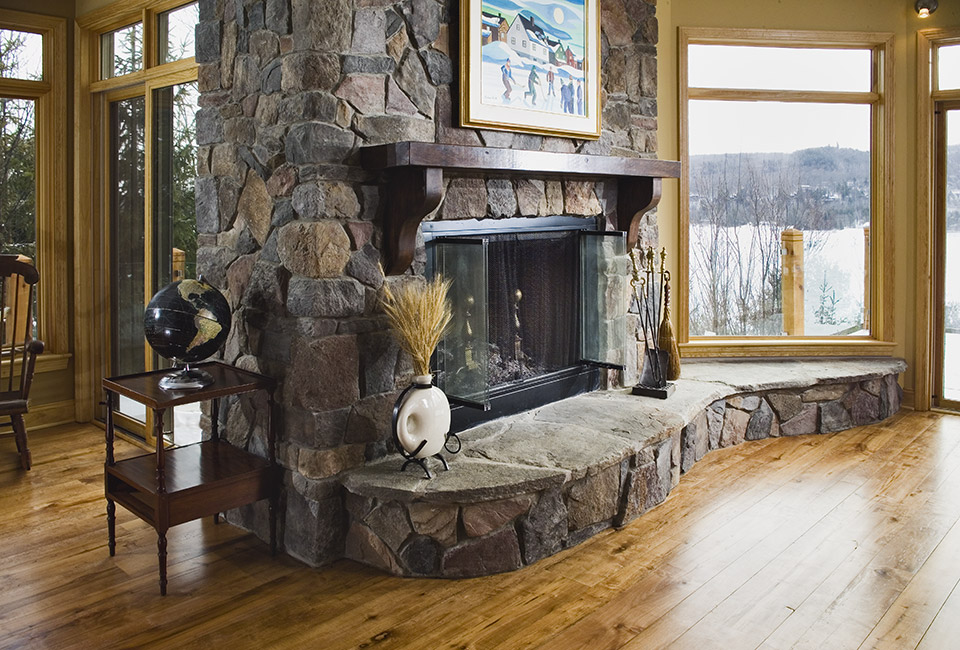 Stone veneer fireplace living room