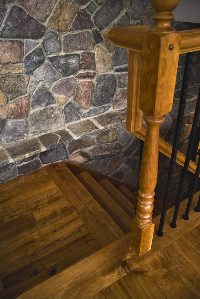 Stone veneer wall in stairs
